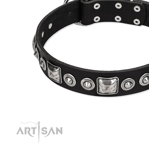Genuine leather dog collar made of soft to touch material with adornments